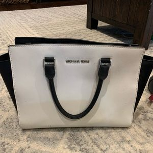 White and Black leather Micheal kors purse